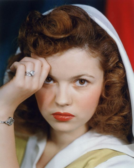 "Shirley Temple/I didn't realize that she had brown eyes and auburn hair. She was also only 5'2""."