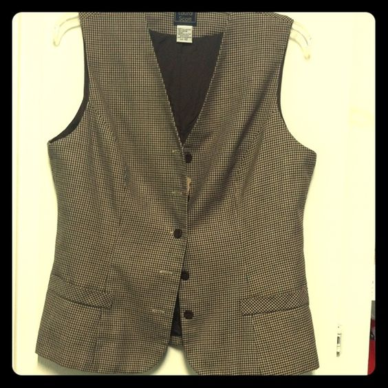 Laura Scott Vest This vest has brown, Black and Tan in it. In excellent condition and would look great with jeans and boots. Flares slightly at the bottom to accommodate for hips!! Laura Scott Jackets & Coats Vests