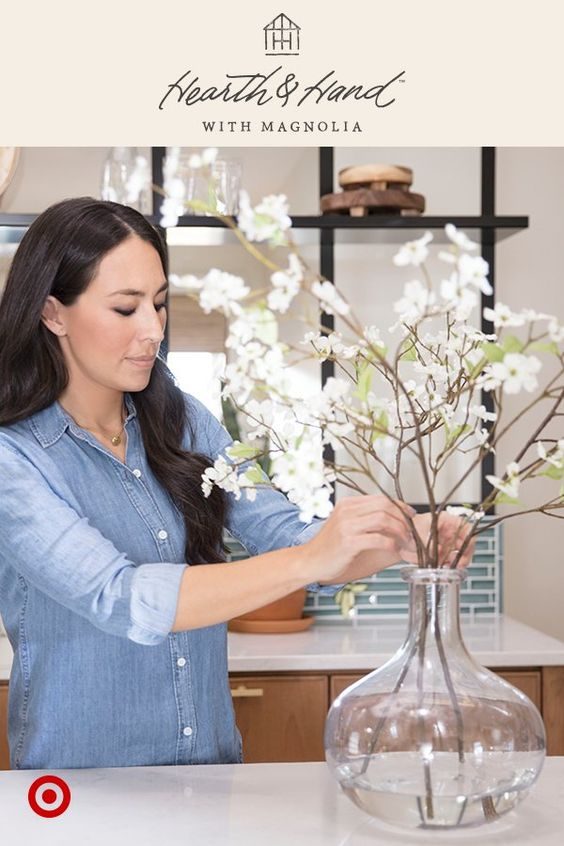 Styling tip from Joanna Gaines: Add water to artificial flowers for a realistic look.