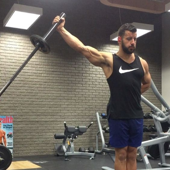 This Shoulder Exercise Should Be A Staple In Your Workouts Shoulder Workout Shoulder Training Planet Fitness Workout