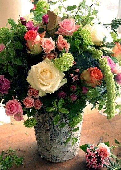rose arrangement in metal bucket*: