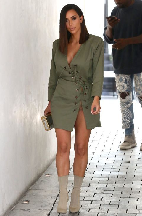 Kim Kardashian wearing a green lace up mini dress with a high-slit and nude sock booties while out to lunch with Kanye West in LA.