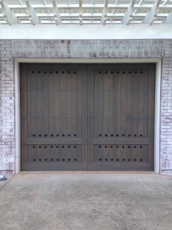 Custom Wood Garage Doors With 2 Inch Nail Head Clavos Garage Door Styles Garage Door Types Custom Wood Garage Doors
