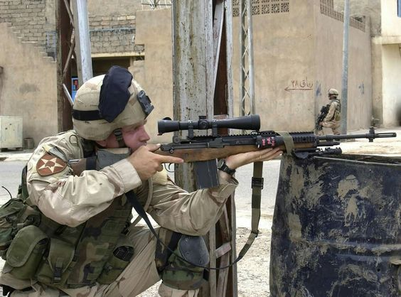 A soldier with the 1 Battalion, 23rd Infantry takes aim with his M25 rifle. Mosul,Iraq May 2004 (US Army photo)