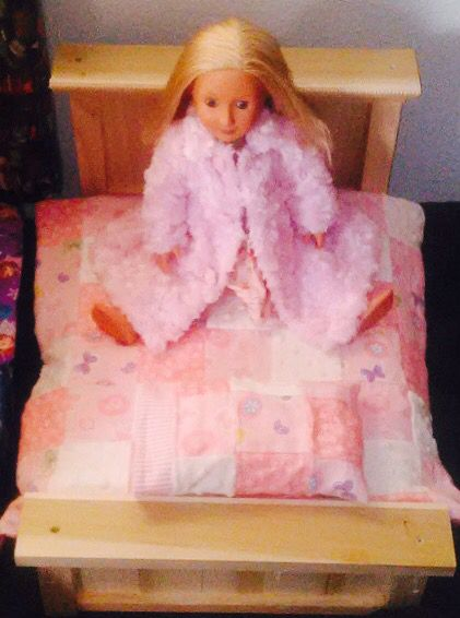 My hubby made our granddaughter a farm style bed and I made the quilt and pink coat. Merry Christmas!