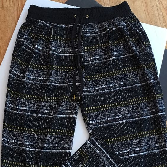 H&M PATTERNED PANTS Trendy!! Soft. Pull on pants with a drawstring waist. One pocket on each side. A wonderful  print on these. Tapered leg. White. Chartreuse. Black. Great with slip on flats or sandals. [pair this with the pictured top] -No trades BUY COMPLETE OUTFIT FOR $30. H&M Pants
