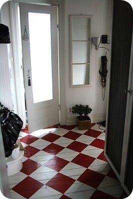 red and soft white painted checkboard floors