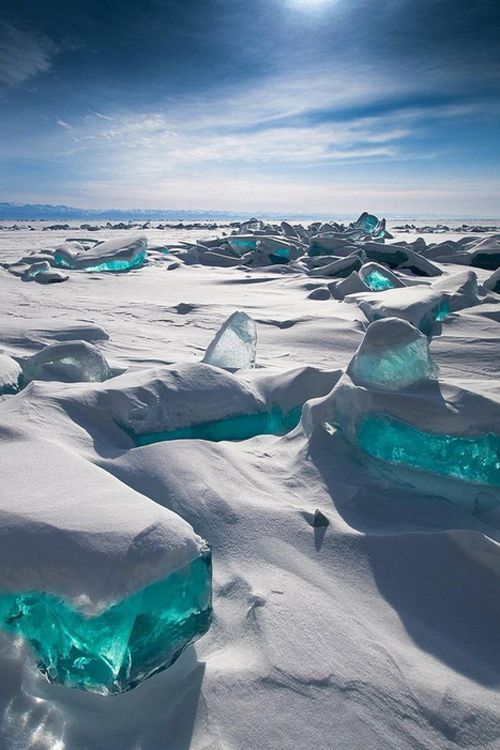 In March, Siberia's Lake Baikal is particularly amazing to photograph. The temperature, wind and sun cause the ice crust to crack and form beautiful turquoise blocks or ice hummocks on the lake's surface. //So pretty EL//