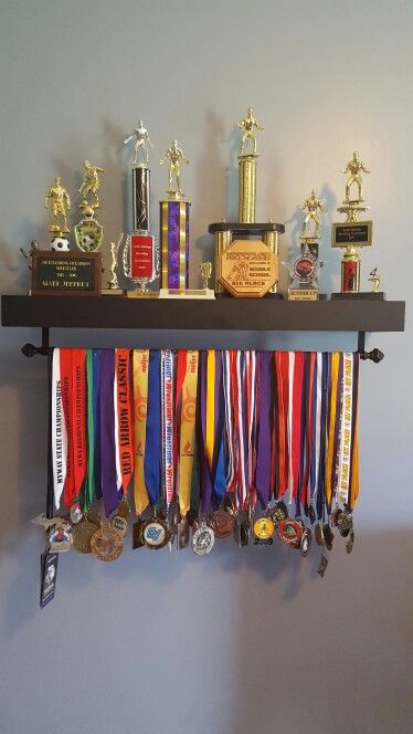 Trophy display trophy shelf and sports medals on pinterest for Display bedroom ideas