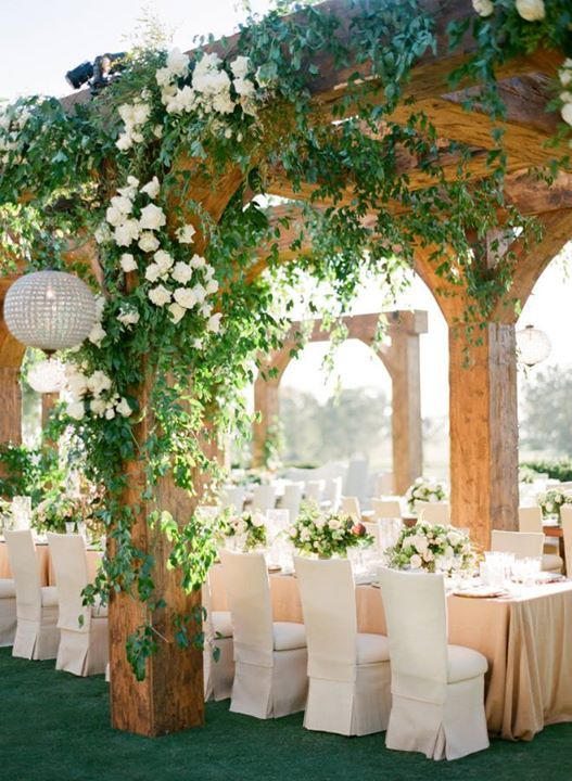 Romantic garden wedding with custom wood structures covered with