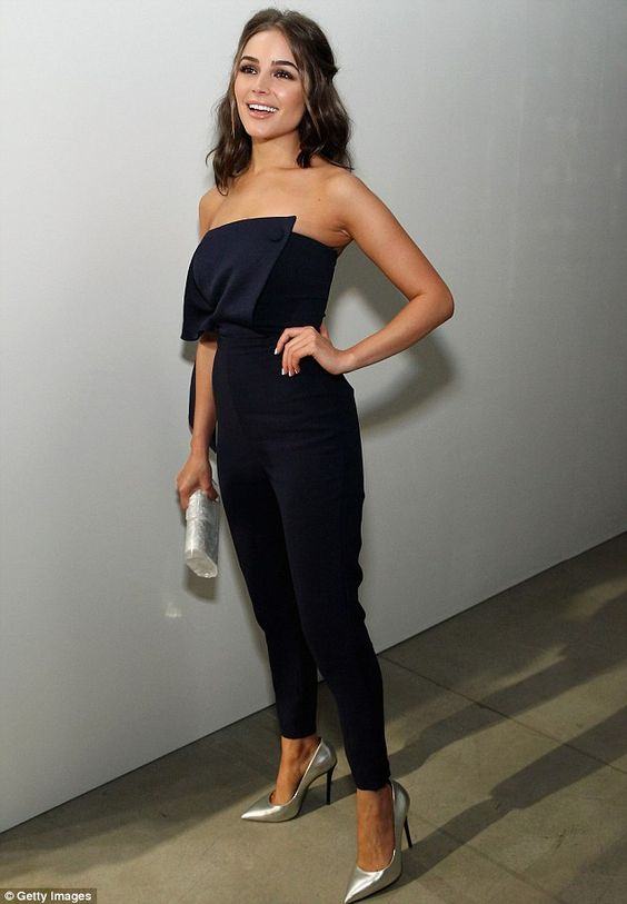 What a beauty: The Miss Universe 2012 kicked off her day with a deep blue jumpsuit that revealed her decolletage