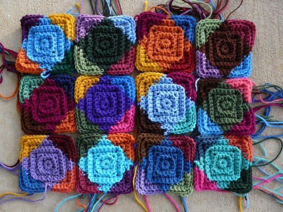 A dozen center squares for the multi-color motifs I am making for my 2012 North Carolina State Fair project.    www.crochetbug.com/making-hay-while-the-sun-shines/