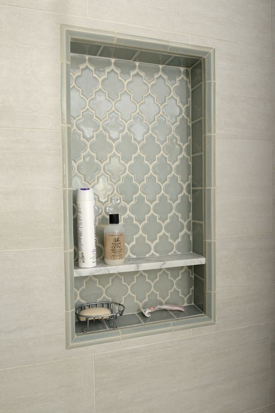 This beautiful hand-made #tile in an arabesque shape would make for a lovely shampoo bottle niche or as a picturesque panel on the back of a shower wall! #TileSensations