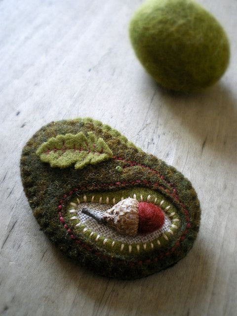 https://flic.kr/p/7E3Qwd | birth of an oak | An idea that sprang forth as I was making it.  It was one of those moments where when I was done sewing I looked down and realized what I had done.  I think it's my desire for spring coming to the surface.  I'm sure there are acorns under all of this snow, waiting to sprout.  I just wish I could see them.  A tiny wool acorn sewn into a brooch made of recycled wool.