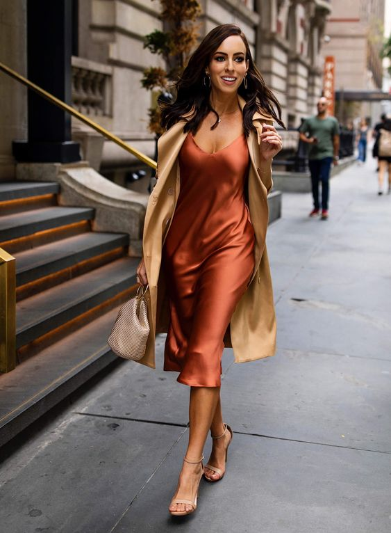 Sydne Style wears l'agence silk trench coat with slip dress at fashion week #trench #trenchcoat #slipdress #silkdress #dresses #rust #pumpkin @sydnesummer