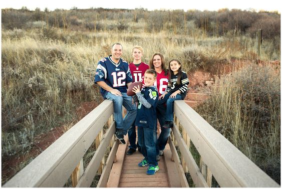 Loveland Family Photos at Devil's Backbone Open Space. Fall Colorado family photography inspiration. Family portraits in football jerseys.