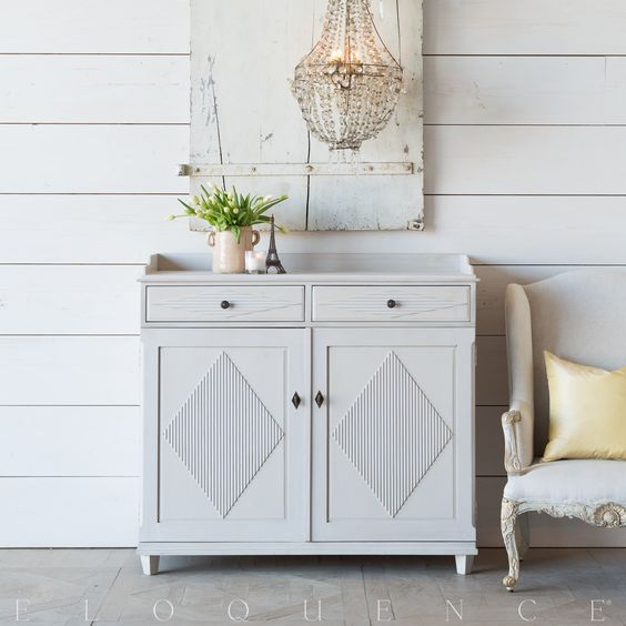 Swedish diamond sideboard cabinet with Empire style chandelier, weathered shutter, and shiplap walls. #FrenchCountry #FrenchNordic