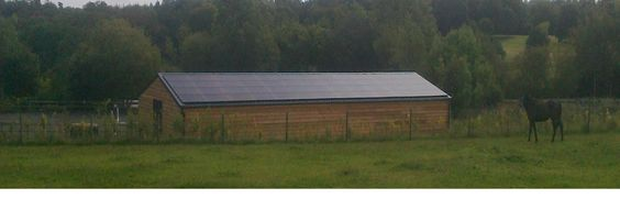 Low profile, all black solar PV panel system.  104 x monocrystalline solar panels, 2 x three Phase AC/DC power inverters supplying power to a number of residential and agricultural buildings and farmhouses.