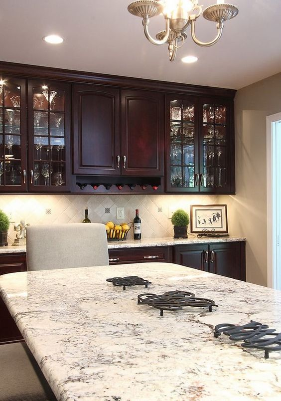 Here we have a thick and beautiful slab of Bianco Romano granite to go along with some gorgeous dark cherry cabinets. It all looks very elegant and decorative with just a small amount of color through the white background.