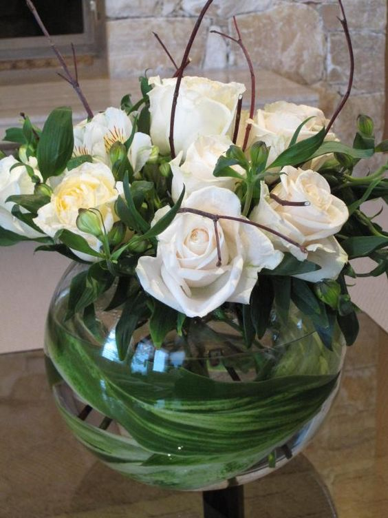 A dozen roses in bubble bowl classic elegance of