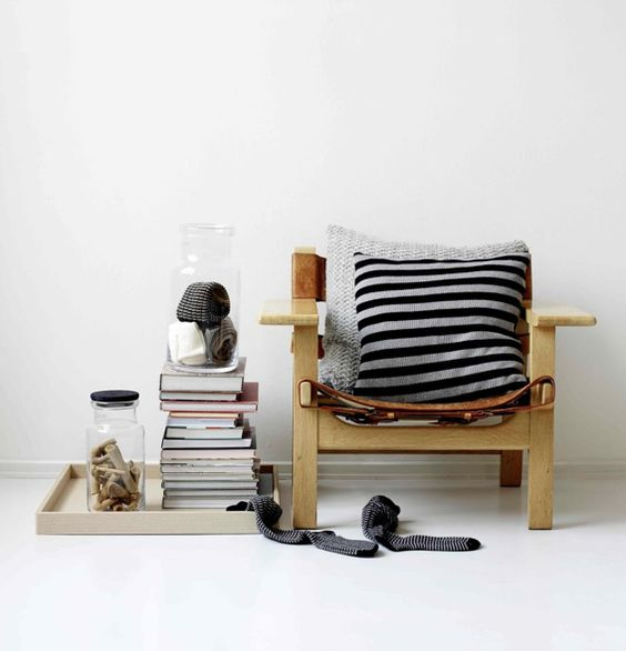 like the simplicity of this and the way the wood and textiles stand out against all the white