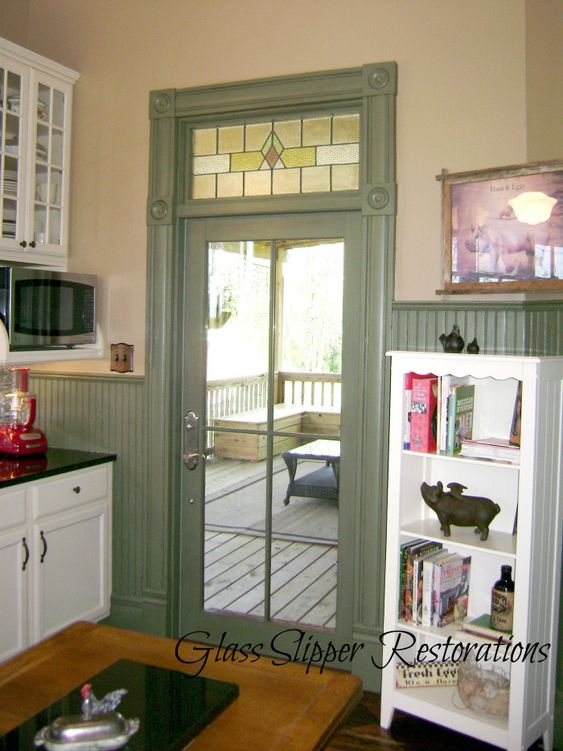 Glass Slipper Restorations farmhouse kitchen - I love the paint colored trim - a nice departure from white!
