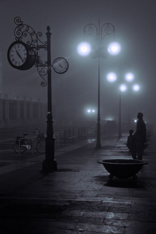 I love that this photo is taken in the dark with the other street lights in the background creating depth and shadows.