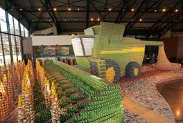 John Deere team creates a sculpture of a combine with canned food (donated to food bank)