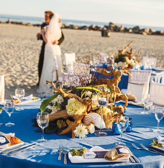 Coronado. Centerpiece: driftwood, seashells, succulents, flowers, sea fan, sea glass in candle