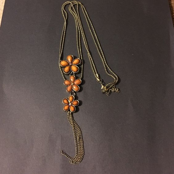 Statement necklace. Stunning long braided chain in tarnished gold with three burnt orange flowers. Jewelry Necklaces
