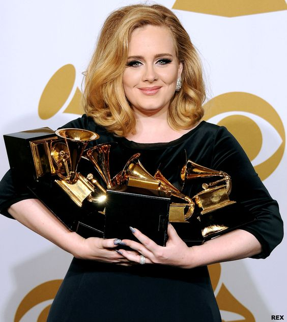 Adele collecting her Grammy's at the 54th Annual Grammy Awards.