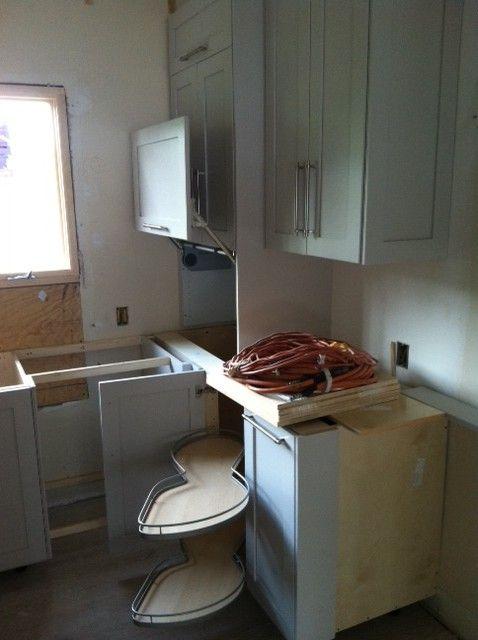 Appliance garage door and swing out blind corner storage