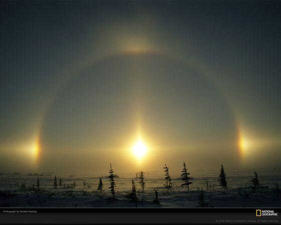 Sundog Light Phenomenon, Manitoba, Canada, 2005.  Photograph by Norbert Rosing #sun