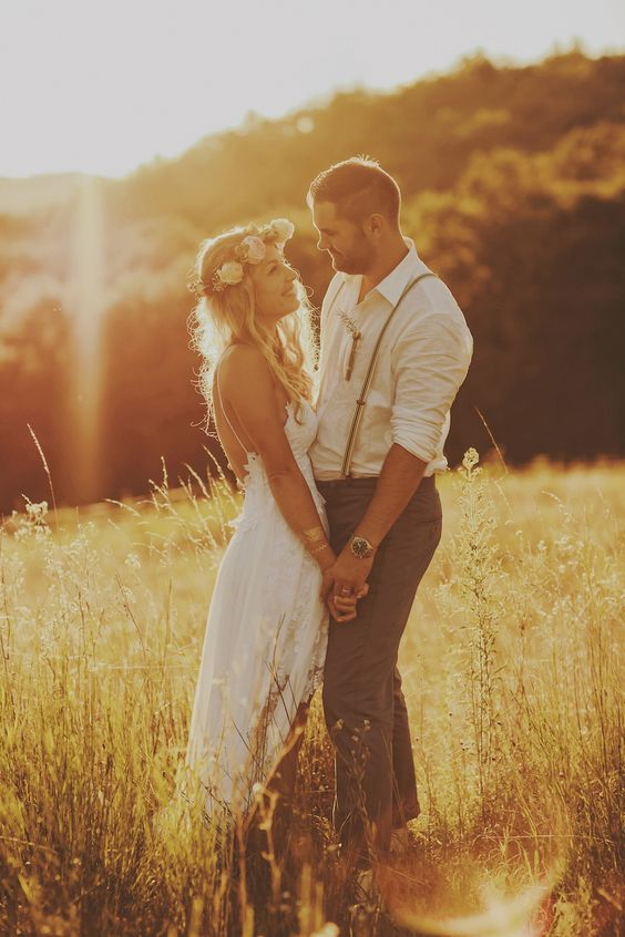 Sunset photos in long grass are so atmospheric and add to the carefree vibe of a bohemian wedding: