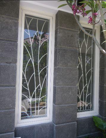 teralis jendela dan pintu rumah ranting daun gambar 44
