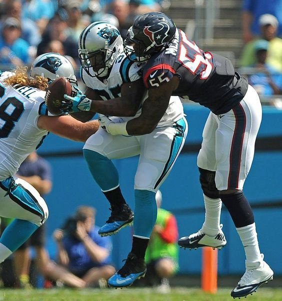Carolina Panthers full back Mike Tolbert, center, leaps to catch a pass from quarterback Cam Newton as Houston Texans linebacker Benardrick McKinney, right, makes the tackle during first quarter action at Bank of America Stadium in Charlotte, NC on Sunday, September 20, 2015. The Panthers defeated the Texans 24-17.
