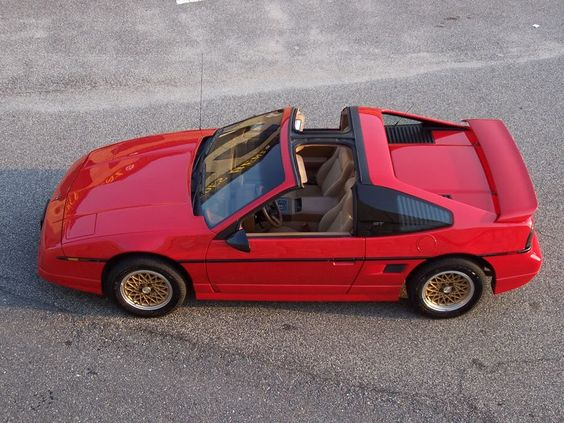 1988 Pontiac Fiero GT. A pretty underrated car. The 1988 had a revised suspension geometry and didn't catch fire as much as everyone thinks. Also with a swapped motor it can beat corvettes easy