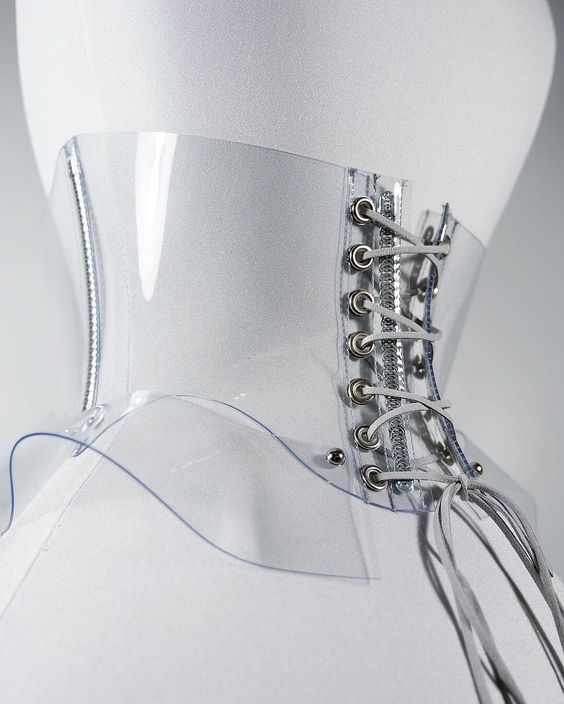 This corset belt is designed for those women that prefer wider accessories. It is made with a high quality clear PVC in the torso and peplum for a dramatic nipped waistline.  The lacing can be used in the front or back.