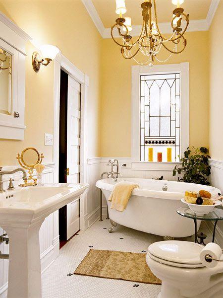 Lovely yellow & white bathroom. Like the wainscott, leaded windows, molding…