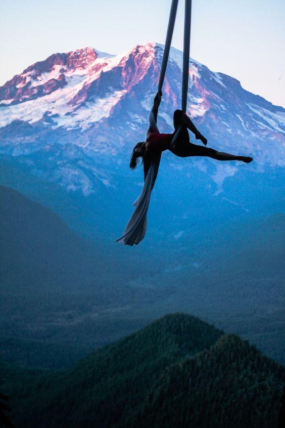 Aerial dance with views of Mount Rainier in Washington. Aerialist: Kaydee Barker PC: Devon Barker