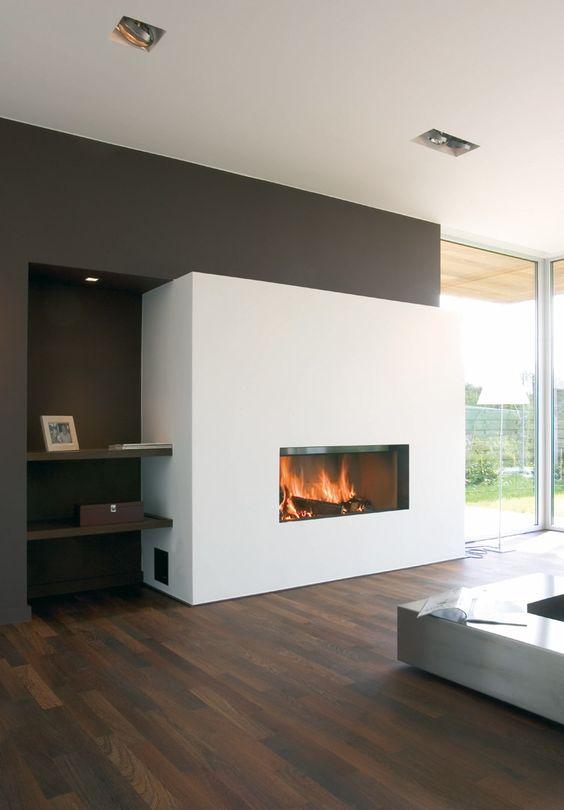 Moderne inbouw houthaard in modern interieur. Houthaard Luna van M-Design past in elk modern interieur.