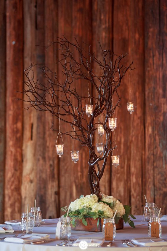 Manzanita tree with hanging votives and hydrangea