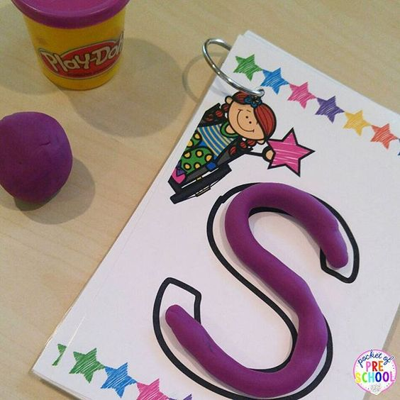 Making letters with playdoh on letter mats helps students learn letters and build their fine motor muscles at the same time.