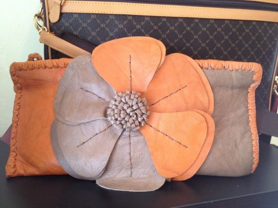 The Clutch is the It Bag. The Skin Bar, Brentwood, TN