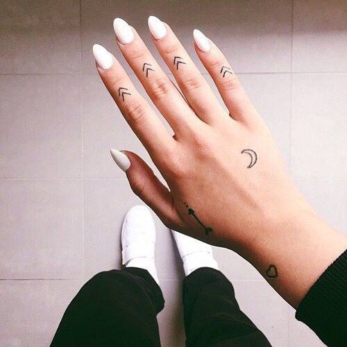Tiny Tattoos On The Hand Chevron Tattoos On Every Thinger Crescent Moon And Arrow On Hand And Heart On The Wrist Hand Tattoos Tattoos Finger Tattoos
