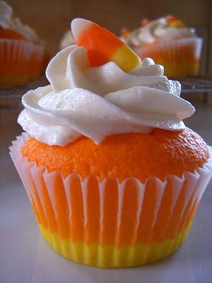 Candycorn theme cupcakes - white cake mix, put 1/2 tsp yellow Wilton food gel in 1/2 the batter & 1/2 tsp orange in other 1/2 - put yellow batter in first, then top with orange before baking