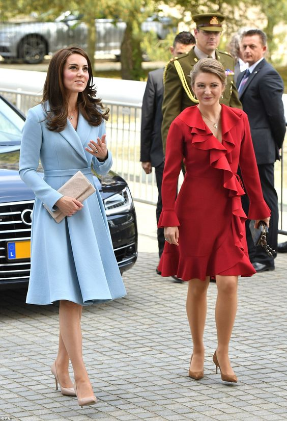 Kate was welcomed to the Musze d'Art Moderne by Crown Princess Stephanie of Luxembourg who looked striking in a ruffled red wrap dress: