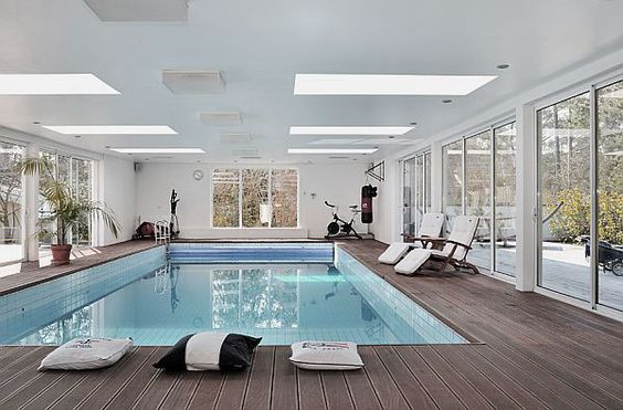 Enchanting Indoor Swimming Pool Design Ideas with Glazed Wall Around