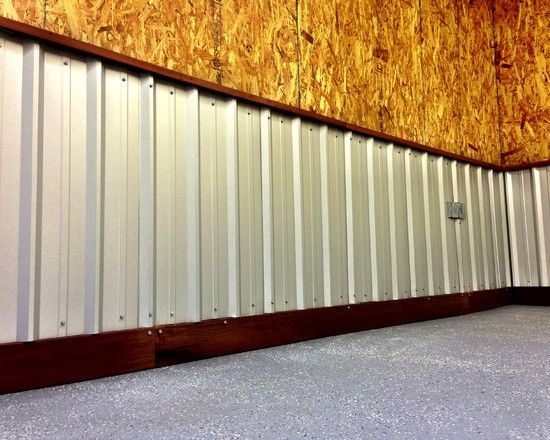 Corrugated metal roofing used as wainscoting with ipe base for Metal wainscoting ideas