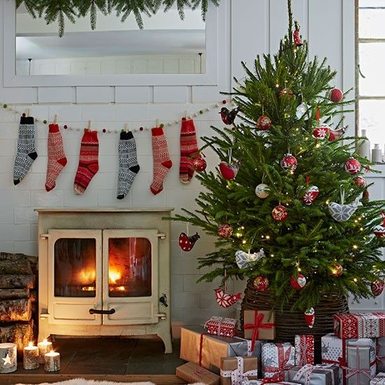 Country Christmas living room with stockings | decorating | Country Homes & Interiors | Housetohome.co.uk